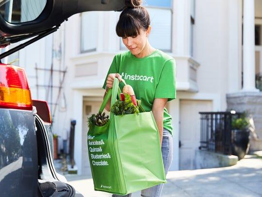 A press photo of an Instacart shopper.