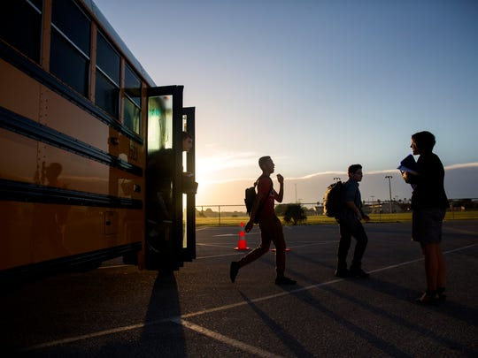 Freshman students get off the bus for their first day