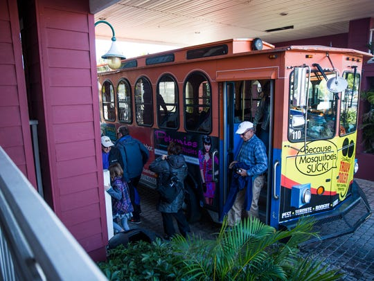 Visitors get off the Naples trolley on Thursday, January