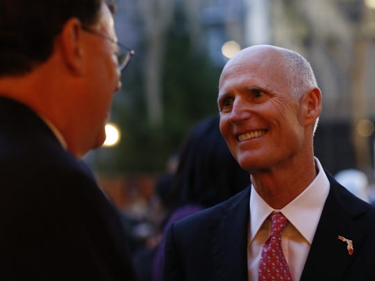 Governor Rick Scott makes his way through a receiving line at Associated Industries of Florida's (AIF) annual reception held on the eve of session, where hundreds of lobbyists, legislators and members of Tallahassee's political set gathered for cocktails and conversation in the courtyard behind AIF headquarters Monday.