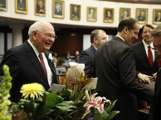 Sen. Bill Montford (D-Tallahassee) speaks to a colleague