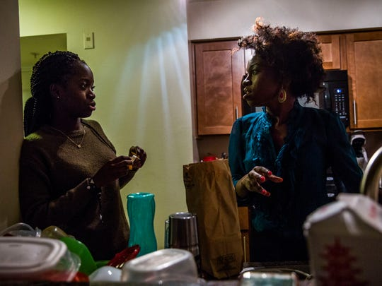 Sisters Sarah Fertil, 16, left, and Wotts Mercy, 25, have dinner in their Naples home on Wednesday, Nov. 29, 2018. Mercy was brought to the U.S. from Haiti with her mother when she was 4 years old. Her mother was deported in 2005 and Mercy is the sole guardian of her sister.