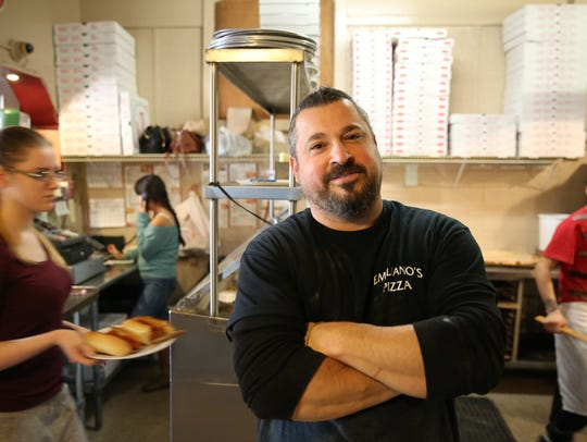 Emiliano Guerriero, co-owner of Emiliano's Pizza in the City of Poughkeepsie, is shown in the Main Street restaurant, Saturday, Jan. 13, 2018.