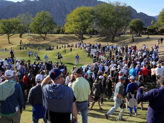 Spectators follow their favorite players during the final round of the CareerBuilder Challenge on Sunday, January 21, 2018 in La Quinta, CA.