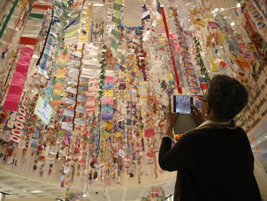 A Capitol visitor admires the artwork of children from
