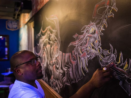 Ryan Holmes draws at the Tin Can bar in 2018, Holmes will be running a chalk art demo at Saturday's festival.