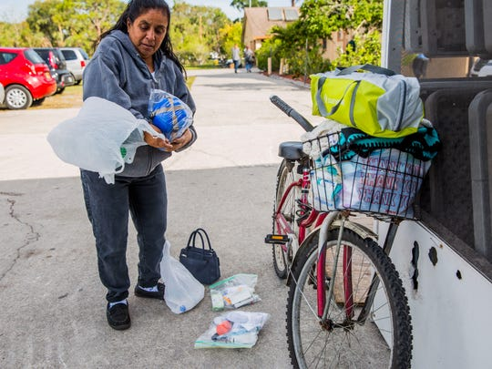 Susanna Rodriguez, 54, packs up her new tent and hygiene kit on her bike during the annual homeless count by The Hunger & Homeless Coalition of Collier County at Guadalupe Social Services in Immokalee on Thursday, Jan. 25, 2018. Rodriguez's home was destroyed in Hurricane Irma last year and she is now homeless.