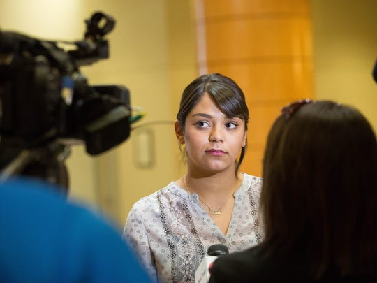 Johana Bencomo takes questions from local media outlets in January 2018 after she spoke out against comments John Vasquez, county commissioner for District 5 and the vice chair of the Doña Ana County Commission, made on Facebook regarding Bencomo and her family.
