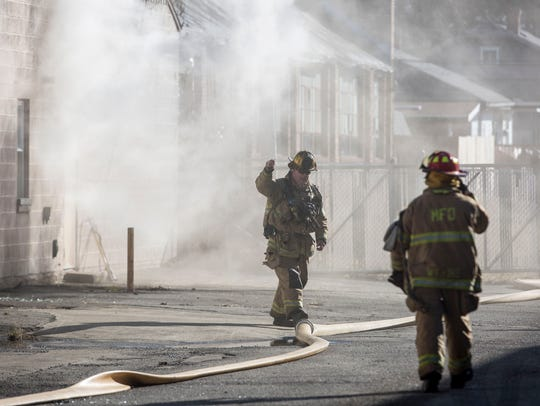 Emergency responders attempt to battle an industrial