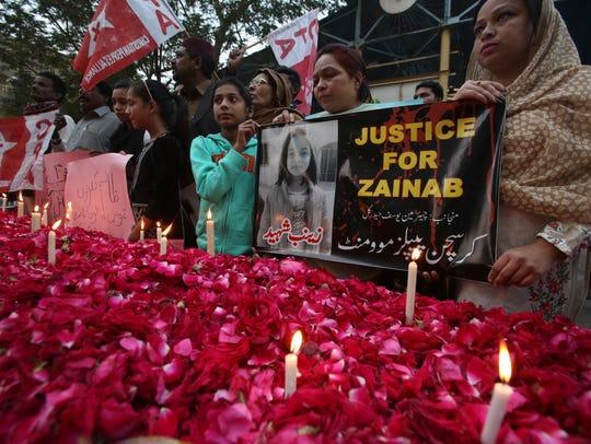 People attend a memorial in Karachi, Pakistan, on Jan.