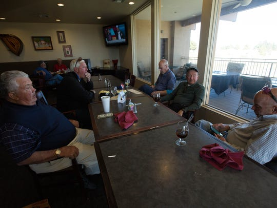 Picacho Hills Country Club members sit in the clubhouse
