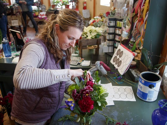 Ali Steiner works on a flower arrangement at her store, Rustic Rose, in New Providence, Iowa, on Wednesday, Jan. 24, 2018.