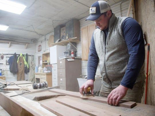 Blake Richie works in his shop at Blake Richie Designs in New Providence, Iowa, on Wednesday, Jan. 17, 2018.