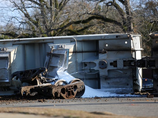 More than half a dozed train cars derailed in downtown Quincy Tuesday morning, partially blocking Pat Thomas Parkway. Two of the cars spilled a crystalline powder called adipic acid, a weak acid with industrial uses.