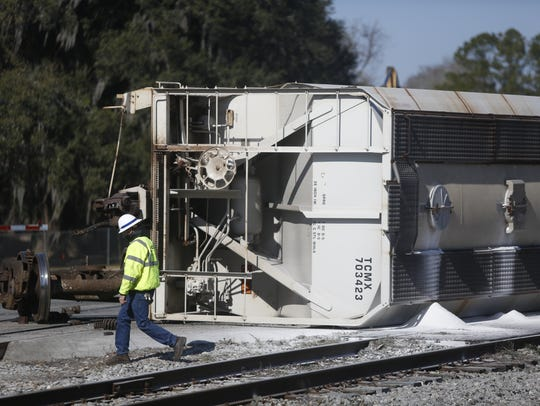 More than half a dozed train cars derailed in downtown