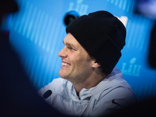 New England Patriots Quarterback Tom Brady smiles during his interview portion of the Super Bowl Opening Night Monday at the Xcel Energy Center.