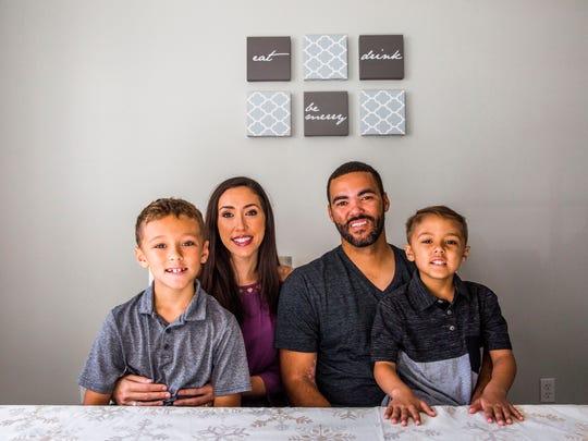 Lisa and Steve Singleton and their sons Steven, 7,