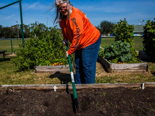 Pam Houndt tends to her garden plot at the Rotary Community