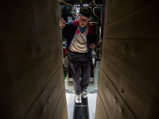 Ernie Kunz, 92, steps onto the walkway after landing during a Wings of Freedom Tour flight for veterans on a Consolidated B-24 Liberator on Thursday, Feb. 1, 2018.