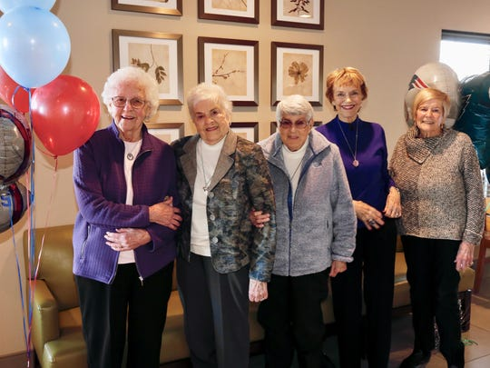 Mary Schmitz, left to right, Joan Cambell, Shirley Shiramm, Karen Winger and longtime Ventura resident Shirley Lorenz Shanahan pose for a photo during a reunion of college roommates Friday in Minneapolis. Shanahan and Winger will attend the Super Bowl on Sunday after saving for three years to go to the big game in their home state.