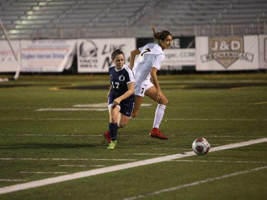 Bishop Verot's Nicole Gulati battles an Oasis player for the ball during the district final.