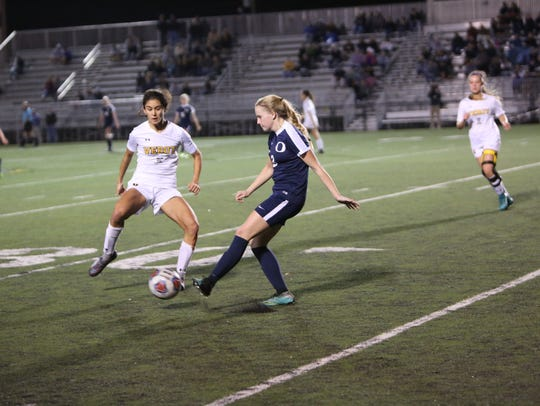 Nina Gulati pressures an Oasis player during the district