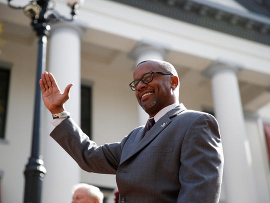 Florida State Head Football Coach Willie Taggart does the chop during FSU Day festivities at the Capitol Tuesday.