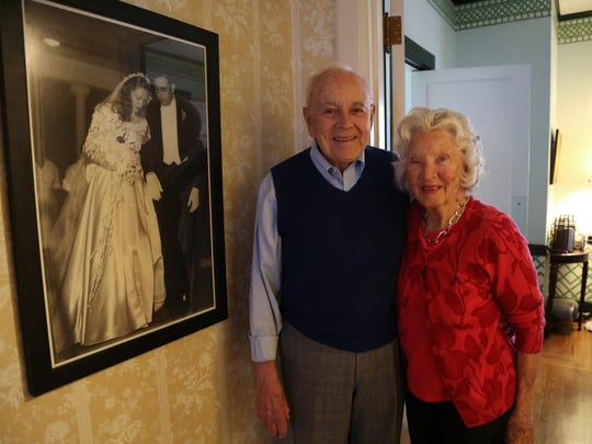 Jack and Mary Weatherford together in their home in Murfreesboro next to a photograph of their wedding day. The longtime Murfreesboro couple celebrated their 70th wedding anniversary last year.
