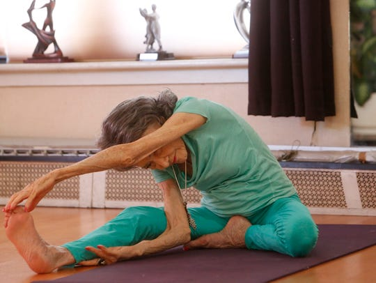 Tao Parchon-Lynch, who will turn 100 in a few months, is the world's oldest yoga teacher and the founder of the Westchester Institute of Yoga, leads a class at the Fred Astaire Studio in Hartsdale on Feb. 5, 2018.