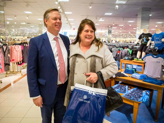 Von Maur President Jim von Maur grabs a photo with customer Jeri Boeve of Rock Valley, Iowa, on Wednesday at the Valley West Mall store.