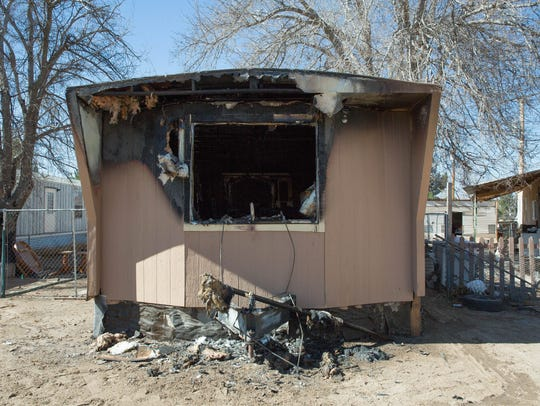 The remains of a mobile home that burnt down in Doña