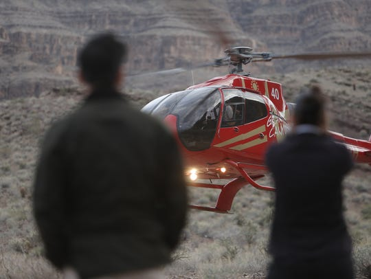 A helicopter flies near the scene of a deadly helicopter
