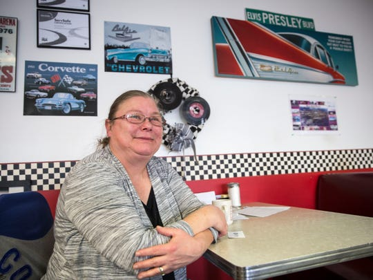 Rita Watkins, owner of the Madision Street Retro Diner for six years, sits in her restaurant after afternoon lunch rush.