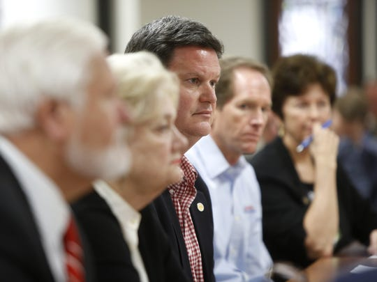 Then County Commissioner and Downtown Improvement Authority board member John Dailey, who's now Tallahassee's mayor, center, during a DIA board meeting in which members contemplate the fate of DIA Executive Director Paige Carter-Smith following revelations that she is under federal investigation in connection to an alleged pay-to-play scheme involving City Commissioner Scott Maddox. The board voted 4-3 to make no changes to the status of Carter-Smith's employment with the authority.