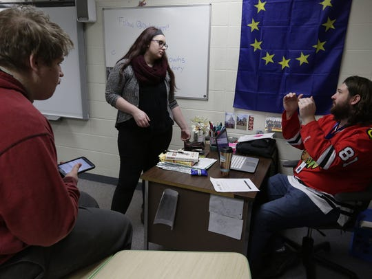 Teacher Will Brydon assists Natalie Jackson, center, and Alexander Jones during a West Mock Trial meeting last year. West's Mock Trial A team will compete in the state competition this weekend in Madison.