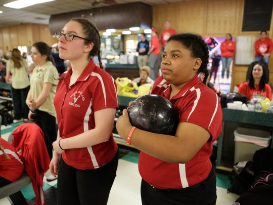 North Rockland's Isabella Palamaro and Akira Deloatch check the scores in the Section 1 girls bowling tournament at Fishkill Bowl in Fishkill on Feb. 12, 2018.