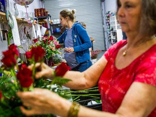 Floral designer Amanda Jerabek, left, and Arlene Pulner work on floral arrangements for Valentine's Day in the back of Petals & Presents Florist in Estero on Monday, Feb. 13, 2018.