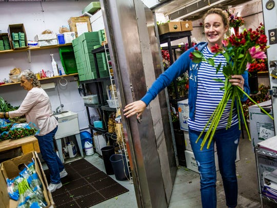 Floral designer Amanda Jerabek, right, works on floral arrangements for Valentine's Day in the back of Petals & Presents Florist in Estero on Monday, Feb. 13, 2018.