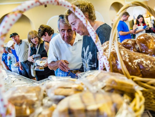 People wait in line to buy Greek pastries during Greek Fest at St. Katherine Greek Orthodox Church in Naples on Friday, Feb. 9, 2018.