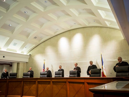 Justice Edward M. Mansfield, left, Justice Brent R. Appel, Justice David Wiggins, Chief Justice Mark S. Cady, Justice Daryl L. Hecht, Justice Thomas D. Waterman and Justice Bruce B. Zager, right, listen to oral arguments on the Planned Parenthood v. Reynolds case at the Iowa Supreme Court Wednesday, Feb. 14, 2018, in Des Moines, Iowa.