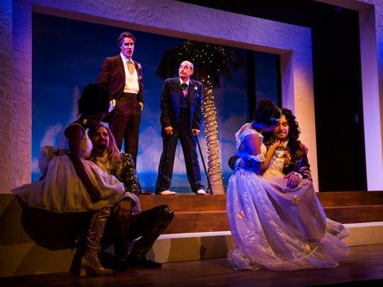Cast members run through a scene during a dress rehearsal