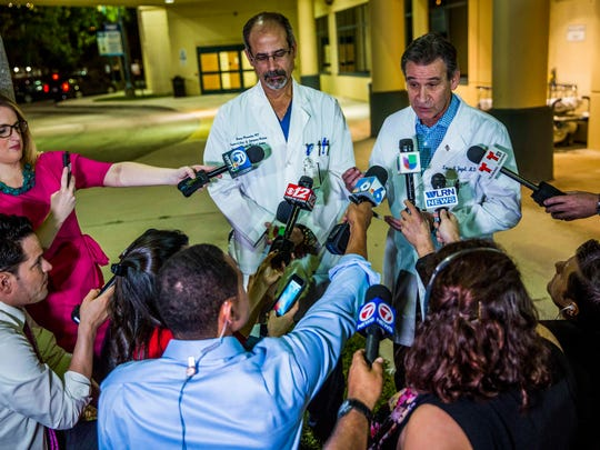 Dr. Benny Menendez, chief of emergency medicine (L) and Dr. Louis Yogel, chief of staff (R) address the media during a press briefing outside of Broward Health Medical Center after a shooting at Marjory Stoneman Douglas High School in Parkland, FL. Mandatory credit: Dorot