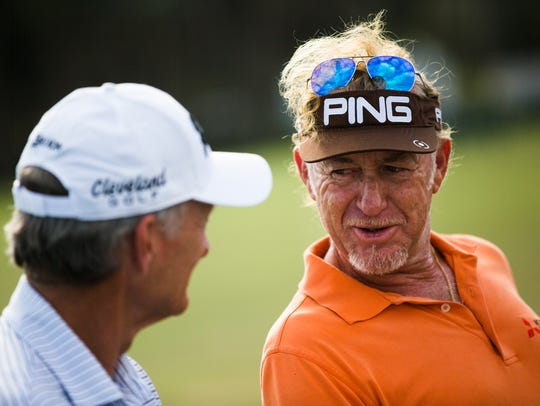 Miguel Angel JimŽenez talks about his golf game with TV analyst and tour player Gary Koch during the Chubb Classic on Thursday at the TwinEagles Club in Naples.