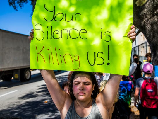 South Broward High School senior Gabriela Bargas protests