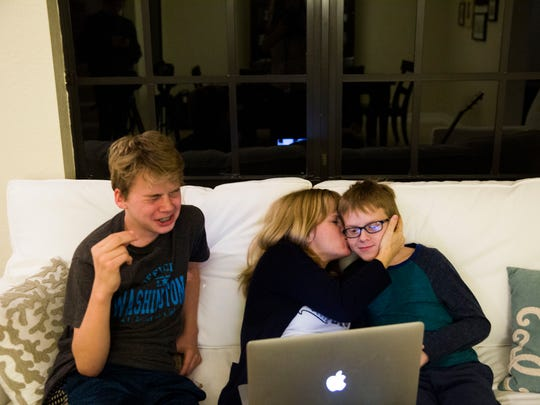 Annika Dean watches videos with her sons Austin, 13,