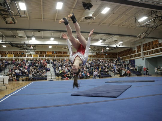 Jam Giubardo competes on the floor exercise during Saturday's Vermont state gymnastics championships at Essex High School.