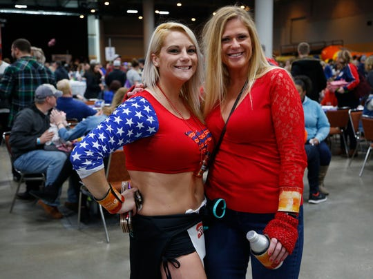 Michele Hartzer and Amber Polson pose for a photo during the 11th annual Blue Ribbon Bacon Festival at the Iowa Events Center Saturday, Feb. 17, 2018.
