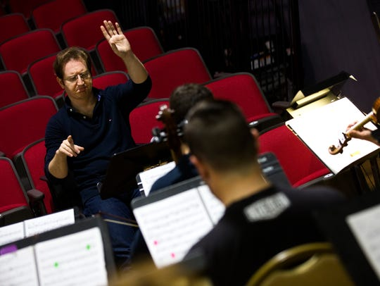Ramón Tebar, artistic director, motions to the musicians