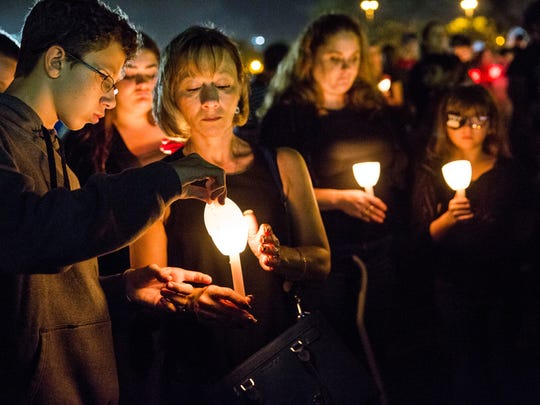 Residents attend a candlelight vigil at Betti Stradling Park in Coral Springs, Fla., on Monday, Feb. 19, 2018. The vigil was organized by the Florida PTA in response to the shooting at Marjory Stoneman Douglas High School on Wednesday that killed 17 people.