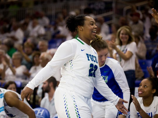 FGCU's China Dow is all smiles as she heads to the bench after playing well against Kennesaw State during an in-conference matchup at Alico Arena Monday, Feb. 19, 2018 in Fort Myers, Fla. FGCU would go on to win clinching first place in the Atlantic Sun.